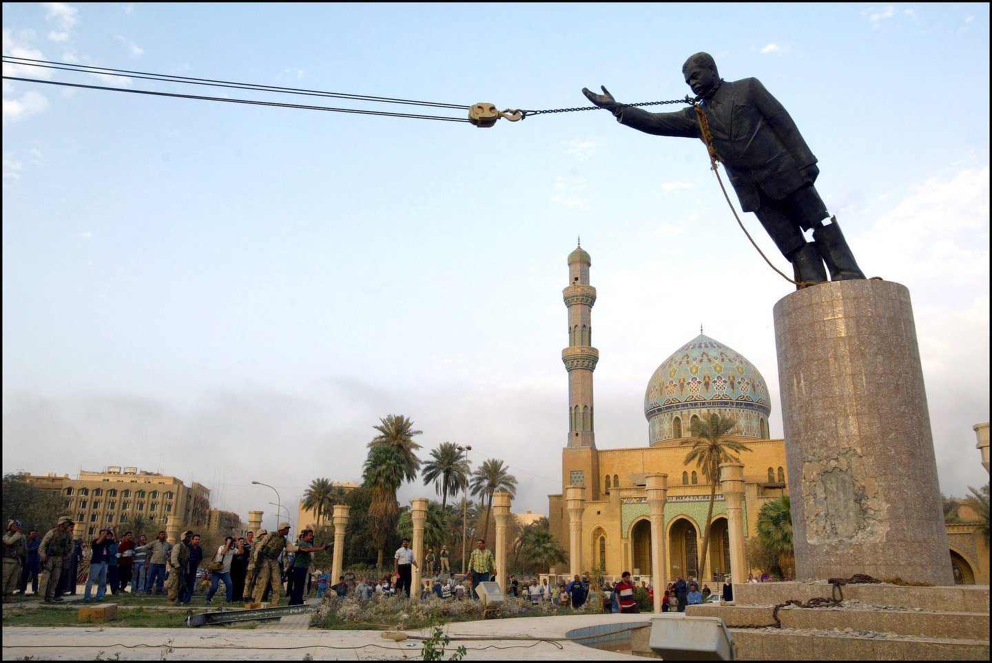 Operation Iraqi Freedom - Day 21: Us Troops Enter Central Baghdad And Topple Statue Of Saddam Hussein On April 9, 2003 In Baghdad, Iraq